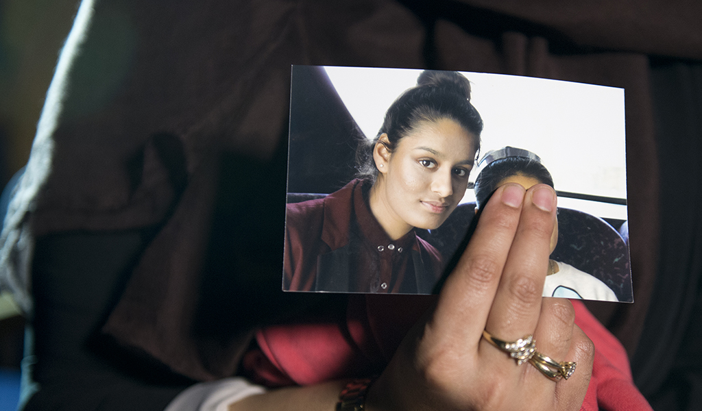 Renu Begum, eldest sister of Shamima Begum, holds her sister's photo as she is interviewed by the media at New Scotland Yard in 2015. Shamima went on to become a jihadi bride - three times over and now wants to return to the UK. (Photo: Laura Lean / WPA Pool / Getty Images)