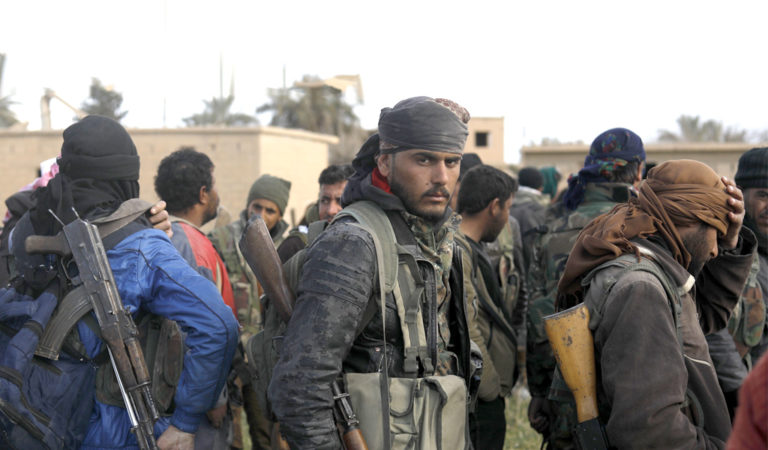 Fighters of the US-backed Syrian Democratic Forces on the frontlines in the Syrian village of Baghuz, ISIS last holdout in Syria (Photo: DELIL SOULEIMAN/AFP/Getty Images)