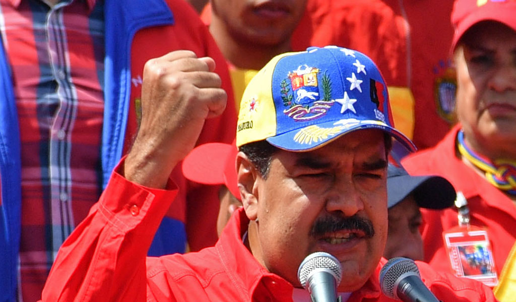 Venezuelan President Nicolas Maduro delivers a speech during a gathering with supporters to mark the 20th anniversary of the rise of power of the late Hugo Chavez, the leftist firebrand who installed a socialist government, in Caracas on February 2, 2019. (Photo: YURI CORTEZ / AFP / Getty Images)