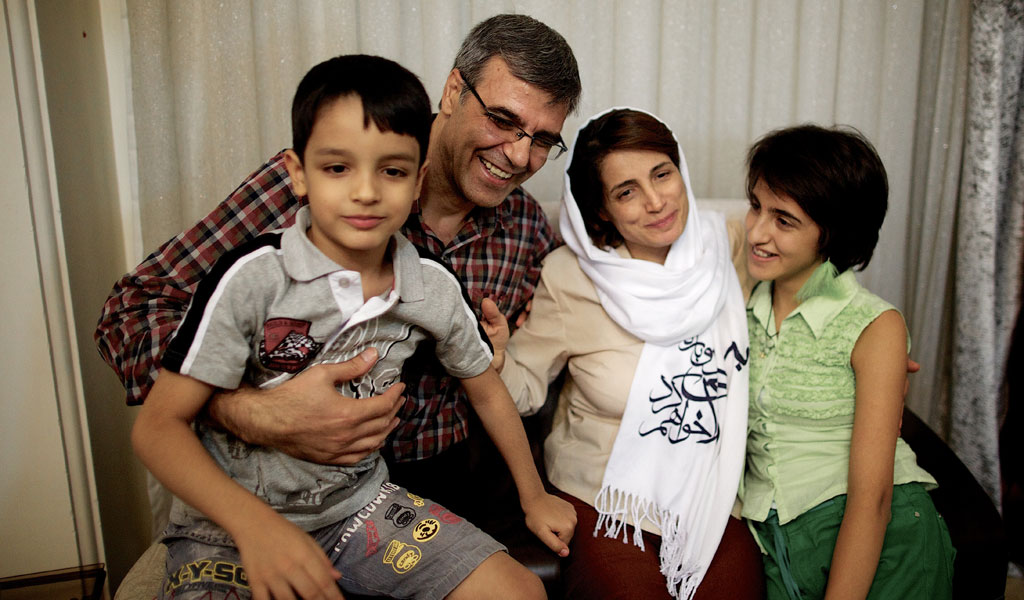 Iranian lawyer Nasrin Sotoudeh with her husband, Reza Khandan, her son Nima and her daughter Mehraveh at her house in Tehran on September 18, 2013, after being freed after three years in prison. (Photo: BEHROUZ MEHRI/AFP/Getty Images)
