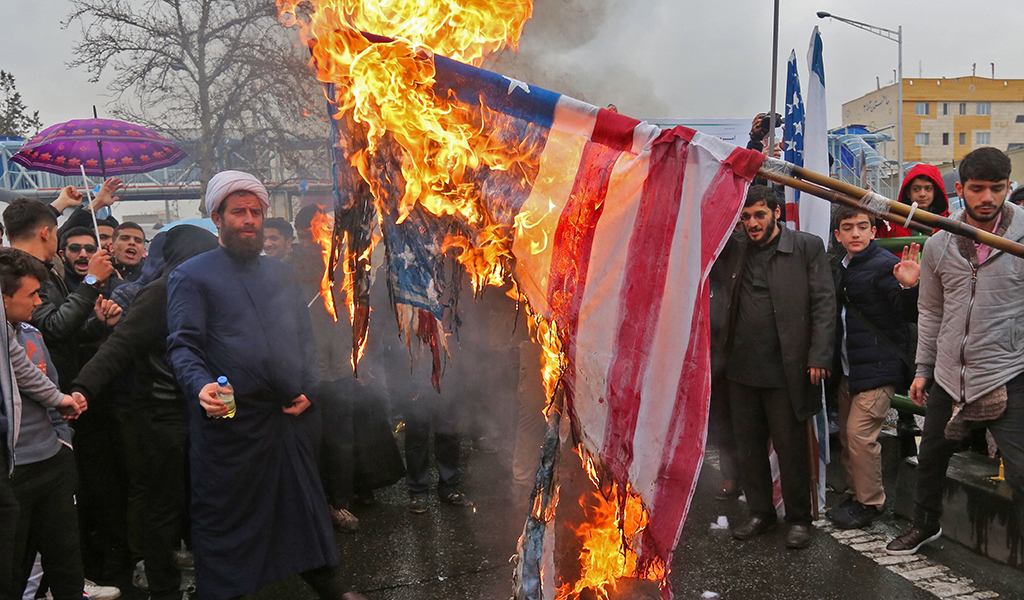 Iranians burn flags of the United States during commemorations of the 40th anniversary of Islamic Revolution in the capital Tehran on February 11, 2019. (Photo: ATTA KENARE / AFP / Getty Images)