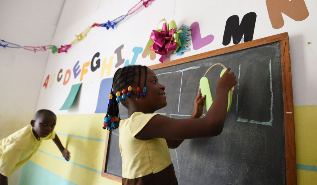A child with autism writes on a blackboard in the Ivory Coast., where there is inadequate infrastructure for special needs children (Photo: SIA KAMBOU/AFP/Getty Images)