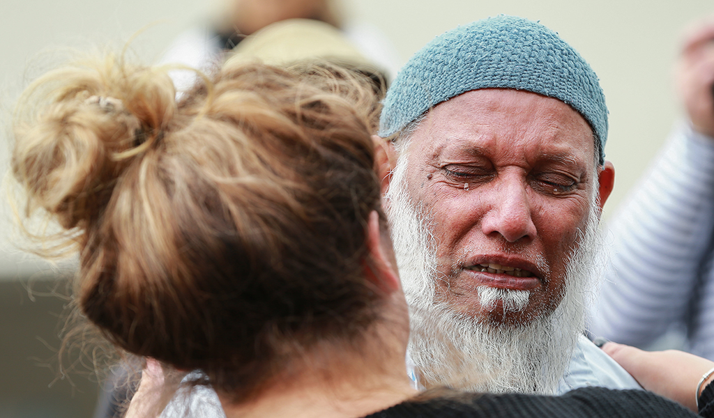 A member of the public and a mosque-goer embrace at the Kilbirnie Mosque on March 17, 2019 in Wellington, New Zealand. 50 people are confirmed dead and 36 are injured still in hospital following shooting attacks on two mosques in Christchurch on Friday, 15 March. The attack is the worst mass shooting in New Zealand's history. (Photo: Hagen Hopkins / Getty Images)