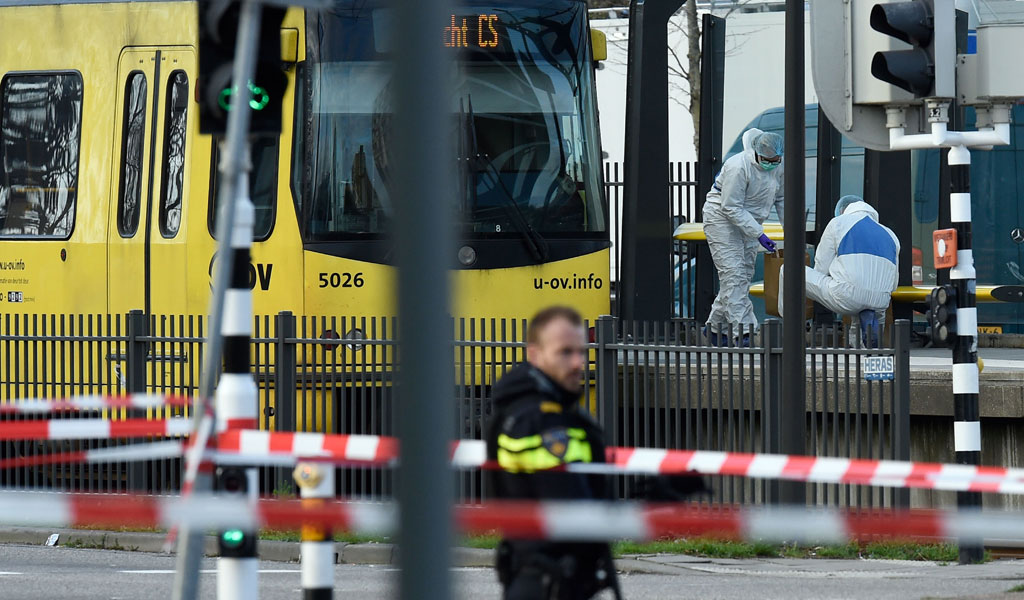 Police and rescuers at work,on March 18, 2019 in Utrecht near a tram where a Turkish gunman opened fire killing at three persons and wounding six (Photo: JOHN THYS/AFP/Getty Images)