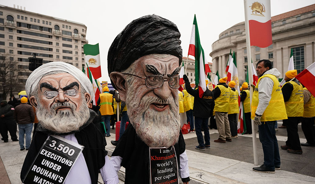 "Effigies of Iranian President Hassan Rouhani (L) and Iran's supreme leader Ayatollah Ali Khamenei (R) march with the Organization of Iranian-American Communities during a rally in support of ""the nationwide uprisings in Iran for regime change"" on March 8, 2019 in Washington, DC. (Photo: MANDEL NGAN / AFP / Getty Images)"