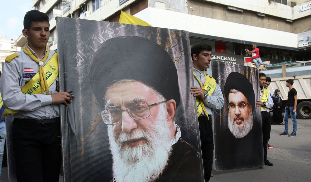 Lebanese Hezbollah supporters. In the foreground is a picture of Iran's Supreme Leader Ayatollah Khamenei, on right is a picture of Hezbollah's leader Hassan Nasrallah (Photo: MAHMOUD ZAYYAT/AFP/Getty Images)