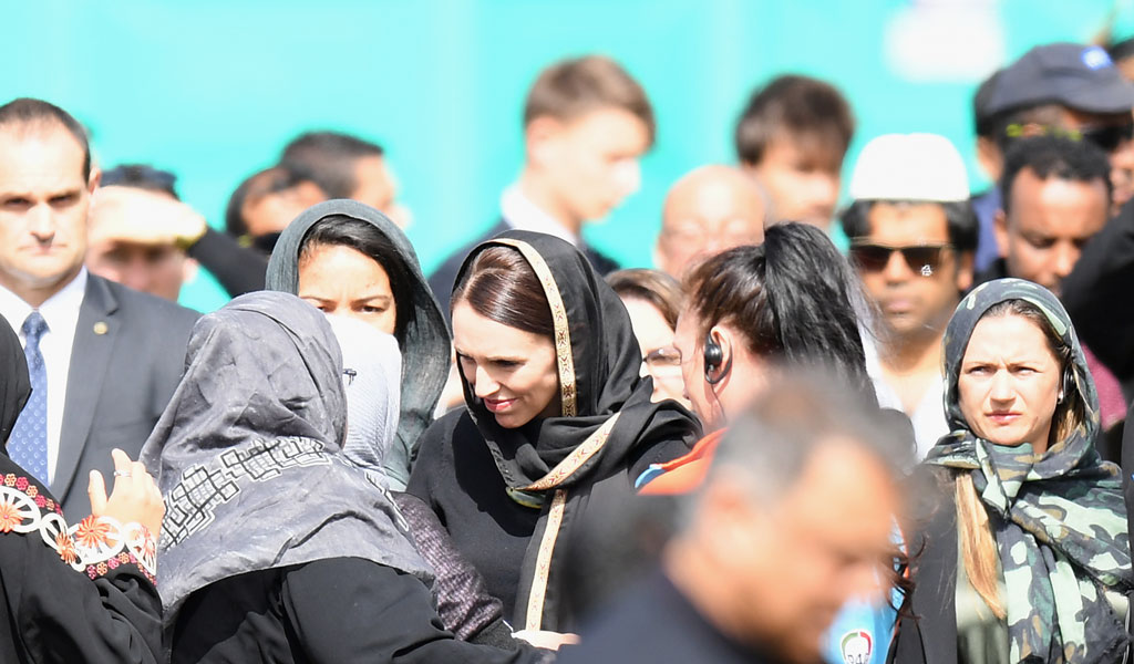 Prime Minister Jacinda Ardern (center wearing a black hijab) greets members of New Zealand's Muslim community at Islamic prayers following the massacre (Photo: Kai Schwoerer/Getty Images)