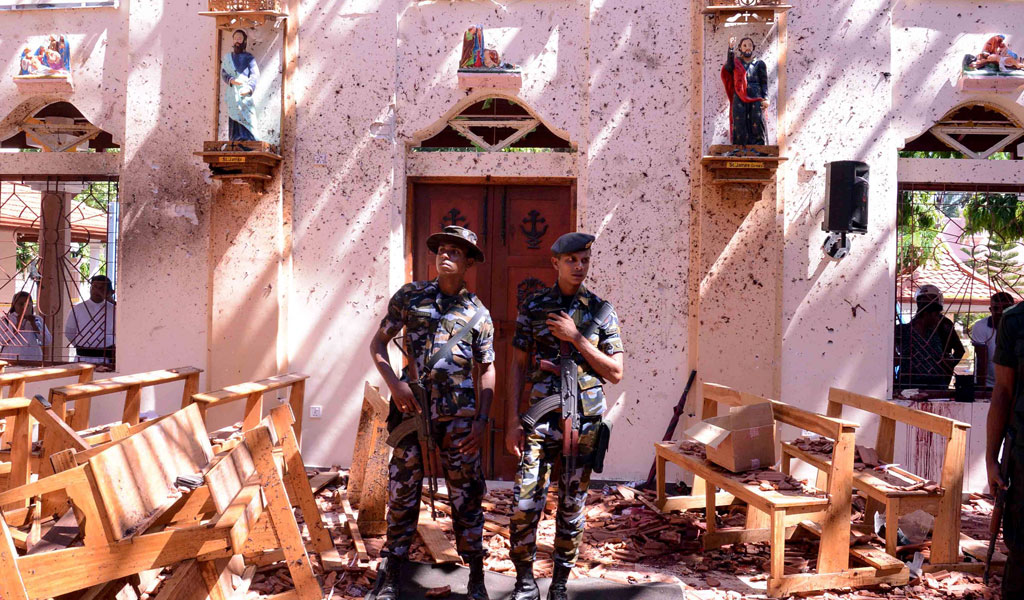 Sri Lankan soldiers outside St. Sebastian's Church in Negombo on April 21, 2019, following a bomb blast during the Easter service that killed tens of people. (Photo: STR/AFP/Getty Images)
