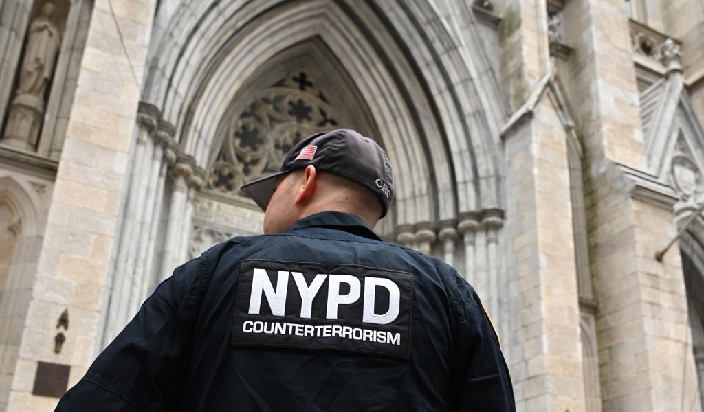 A New York Police Department officer outside St. Patrick's Cathedral in Manhattan on April 18, 2019, the morning after a man was arrested after trying to enter the Cathedral carrying two cans of gasoline, lighter fluid and butane lighters just days after a fire badly damaged the Notre Dame Cathedral in Paris. NYPD said the arrested man claimed he was taking a shortcut through the cathedral after his car ran out of fuel, but his answers were 'inconsistent and evasive.' (Photo: TIMOTHY A. CLARY/AFP/Getty Images)