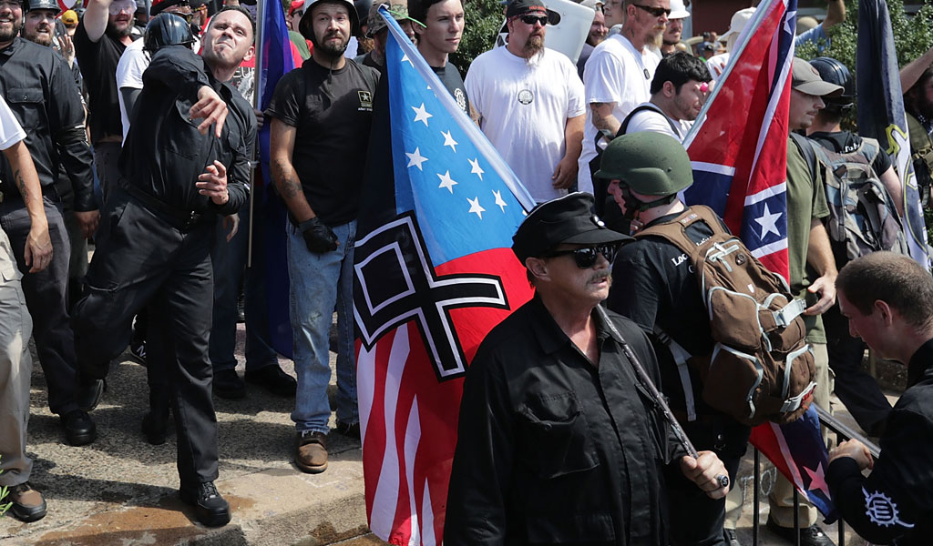 Hundreds of white nationalists, neo-Nazis, and KKK members hurl water bottles back and forth against counter demonstrators during the Unite the Right rally August 12, 2017 in Charlottesville, Virginia. (Photo: Chip Somodevilla/Getty Images)