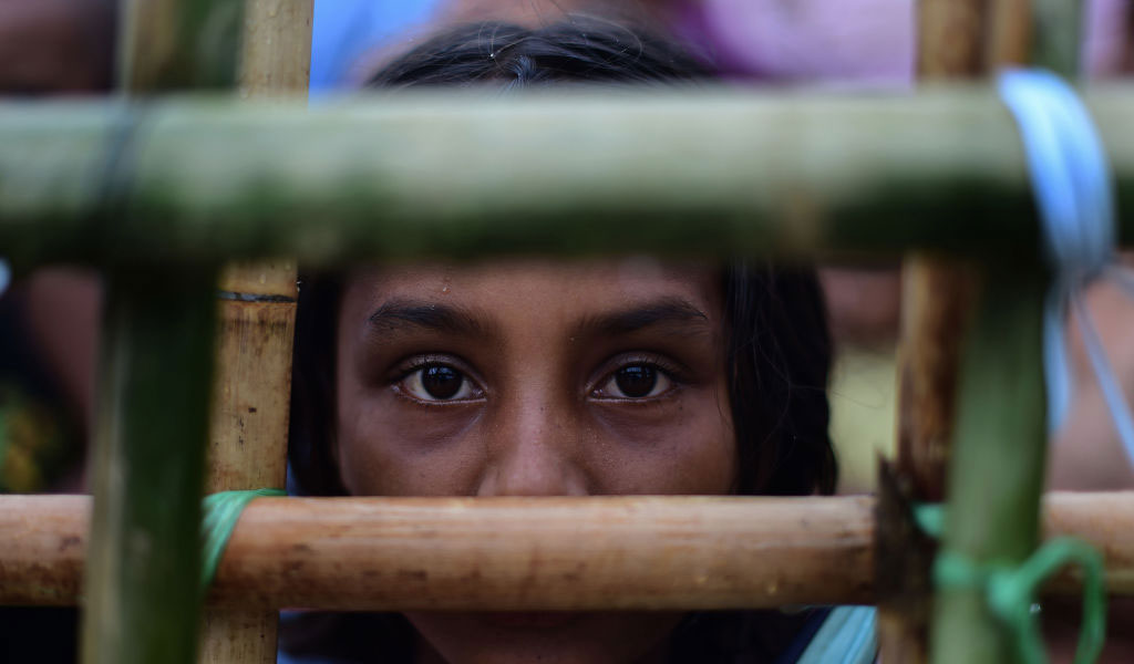 A Rohingya refugee girl waits to collect relief materials in a Bangladeshi refugee camp. (Illustrative Photo: MUNIR UZ ZAMAN/AFP/Getty Images)