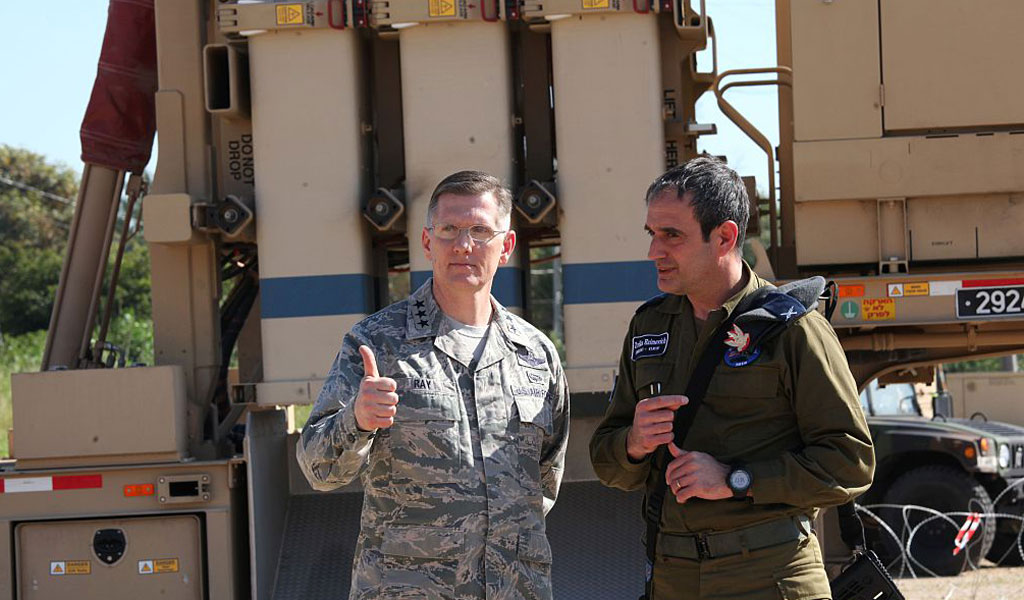 Commander of the Israeli Aerial Defense Division, Brigadier Gen. Tzvika Haimovich (R), and American 3rd Air Force Commander, Lt. Gen Timothy Ray speak near the Israeli Defense Forces military system David's Sling after viewing Juniper Cobra's joint exercise press briefing at an Israeli air force base in central Israel on February 25, 2016. Juniper Cobra, is held every two years where Israel and the United States train their militaries together to prepare against possible ballistic missile attacks, as well as allowing the armies to learn to better work together. (Photo: GIL COHEN-MAGEN/AFP/Getty Images)
