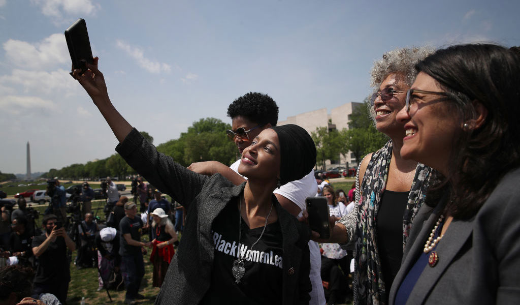 Congresswoman Ilhan Omar takes a selfie with Rep. Rashida Tlaib and Communist activist and Black Panther leader Angela Davis (2nd R) at an event outside the U.S. Capitol. Omar and others called on Democratic leaders Speaker Nancy Pelosi and Senate Minority Leader Chuck Schumer to 'censure President Trump for inciting violence against Omar.' (Photo: Win McNamee/Getty Images)