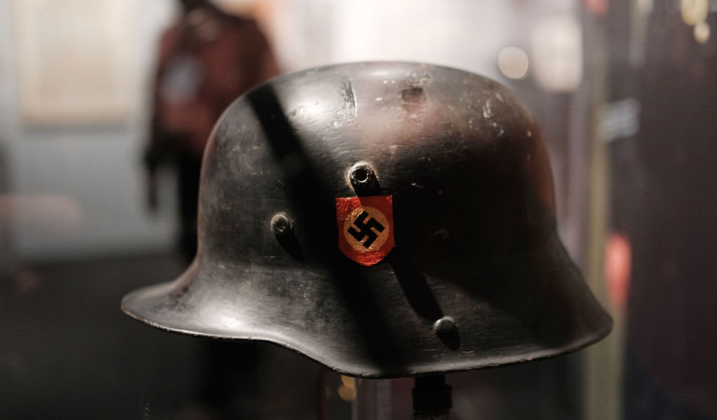 A German helmet with a swastika is displayed at an exhibition at the Museum of Jewish Heritage in May 2019 in New York titled 'Auschwitz. Not long ago. Not far away.'