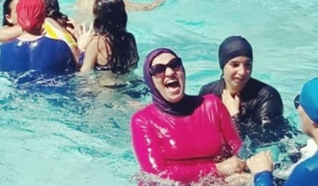 Women in Grenoble, France defy the burkini ban at a city pool (Photo: Citizen Alliance of Grenoble/Facebook)