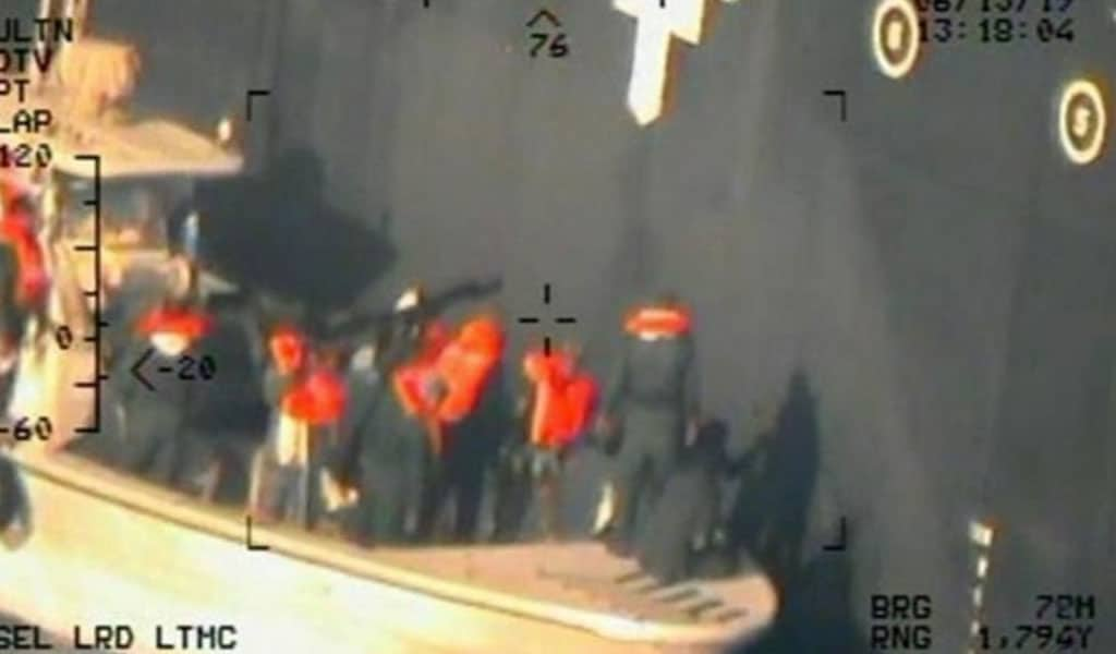 A photo released by the Pentagon shows Iranians removing an unexploded mine off a tanker in the Gulf of Oman (Photo: U.S. Navy)
