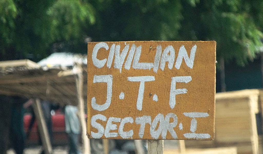 A sign near a checkpoint of a vigilante group reads Civilian J.T.F (Joint Task Force) Maiduguri, an area where the Islamist terror group Boko Haram has carried many deadly attacks. Young men and women formed vigilante groups to hunt down these terrorists and have had success. (Photo: AMINU ABUBAKAR/AFP/Getty Images)