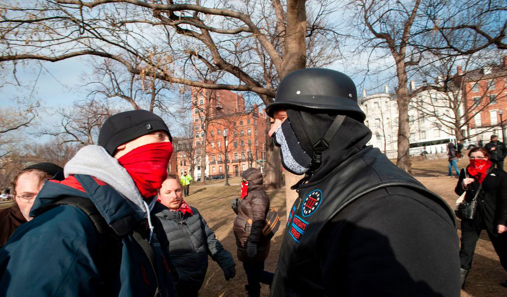 Members of a right wing group (R) clash with Antifa members during the 2019 Women's March at Boston Common in Boston, Massachusetts, January 19, 2019. ((Photo: JOSEPH PREZIOSO/AFP/Getty Images)