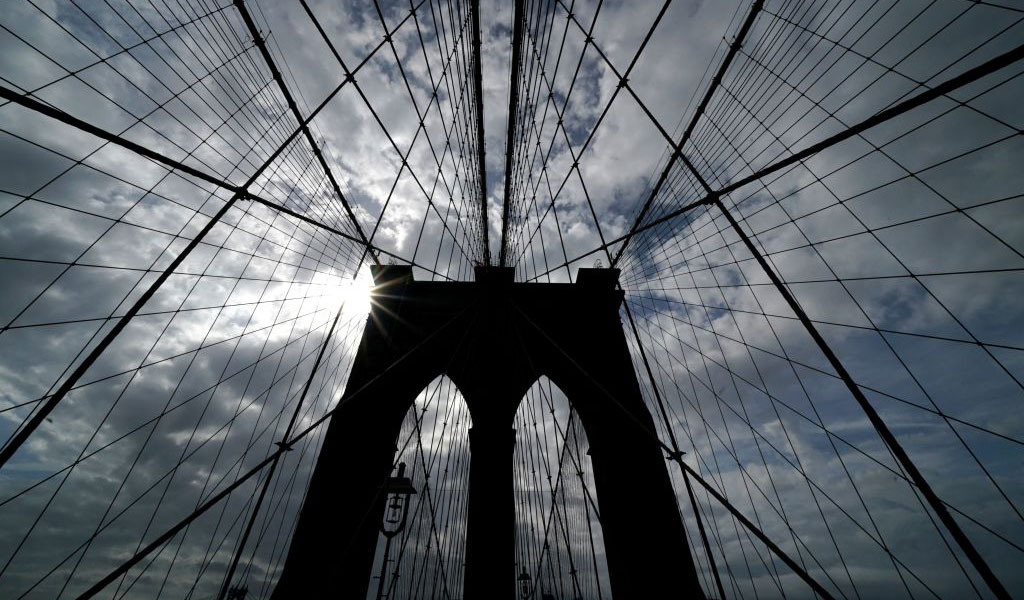 The suspension cables holding up the Brooklyn Bridge. Iymam Faris was in on a plot to cut them. (Photo: TIMOTHY A. CLARY/AFP/Getty Images)