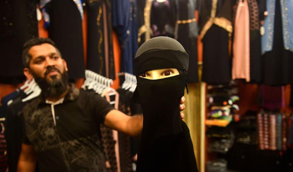A Sri Lankan vendor shows a niqab (full-face veil) at a shop selling clothes for Muslim. The government banned face covering in public after the Easter Sunday suicide attacks (Photo: ISHARA S. KODIKARA/AFP/Getty Images)
