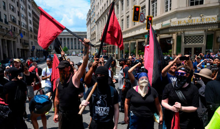 Members Antifa march against a 'Demand Free Speech' rally in Washington, DC on July 6, 2019. (Photo: ANDREW CABALLERO-REYNOLDS/AFP/Getty Images)