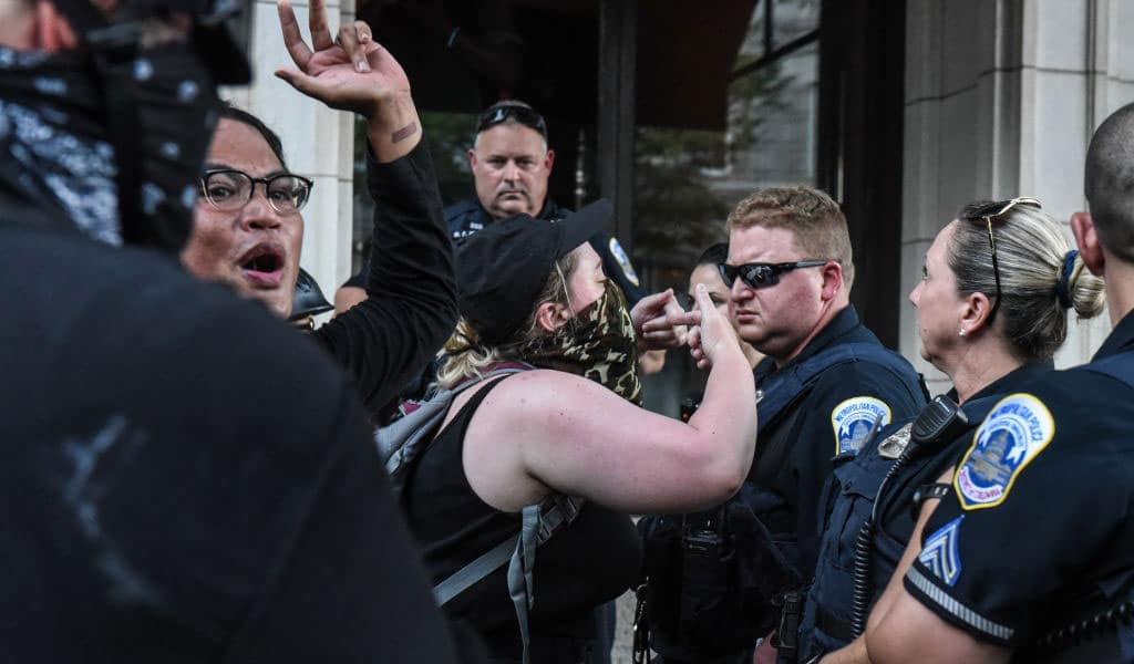 Antifa extremists protesting against a 'Demand Free Speech' rally in July 2019 in Washington, DC. Antifa objected to the free speech demonstrators who were rallying for social media companies to stop their censorship (Photo: Stephanie Keith/Getty Images)