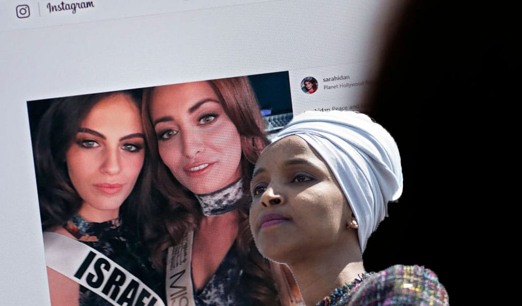 Miss Iraq Sarah Idan takes a selfie with Miss Israel Adar Gandelsman (Photo: THOMAS COEX/AFP/Getty Images); Inset: Congresswoman Ilhan Omar (Photo: Zach Gibson/Getty Images)