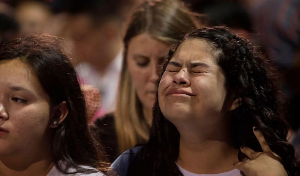 At a candlelight vigil for the victims of the El Paso Shootings (Photo: MARK RALSTON/AFP/Getty Images)