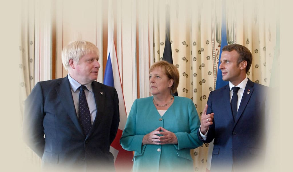 British Prime Minister Boris Johnson, German Chancellor Angela Merkel and French President Emmanuel Macron pose during a G7 coordination meeting with the Group of Seven European members August 2019 in Biarritz, France. (Photo: Andrew Parsons - Pool/Getty Images)