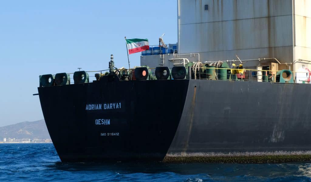 An Iranian flag on board the Adrian Darya oil tanker, formerly known as Grace 1, off the coast of Gibraltar on August 18, 2019. Gibraltar rejected a US demand to seize the tanker, leaving the tanker free to leave the British territory after weeks of detention. (Photo: JOHNNY BUGEJA/AFP/Getty Images)