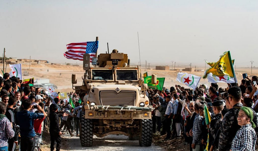 Syrian Kurds demonstrate against Turkish threats in El-Arqam near the Turkish border, pleading with the American to stop the Turks (Photo by Delil SOULEIMAN / AFP) (Photo by DELIL SOULEIMAN/AFP via Getty Images)