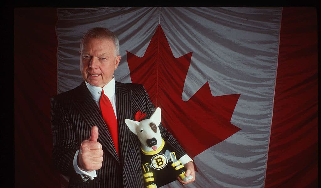 Canadian hockey icon Don Cherry poses holding a Boston Bruin dog (Photo: Getty Images)