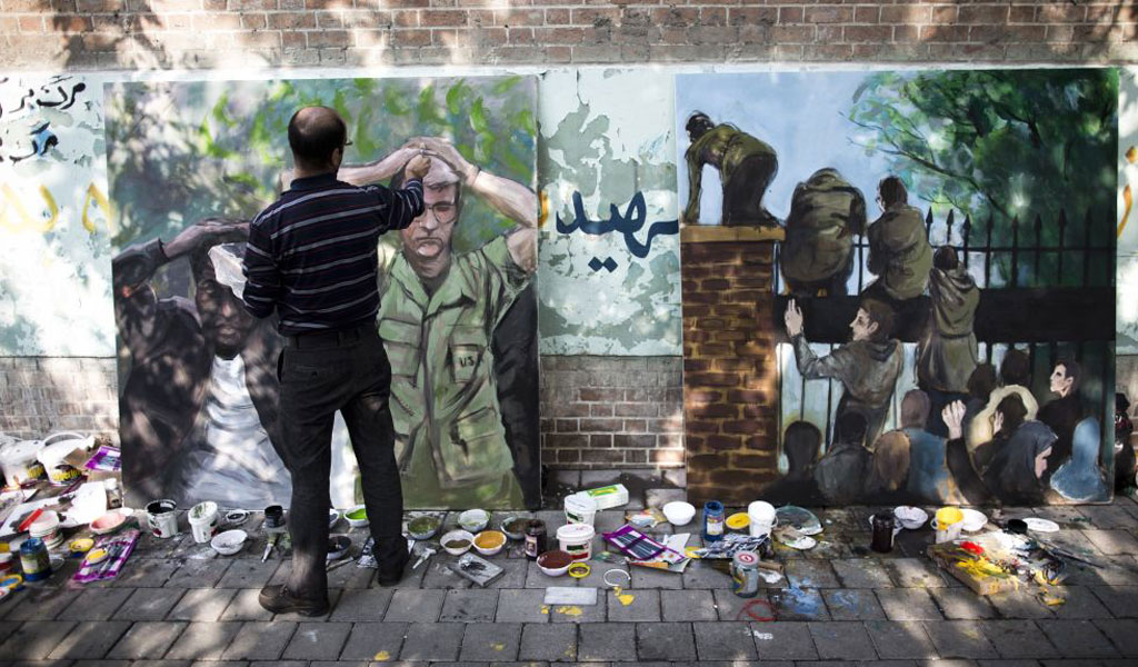 A painting depicting the 1979 US embassy takeover in Iran (Photo: BEHROUZ MEHRI/AFP via Getty Images)