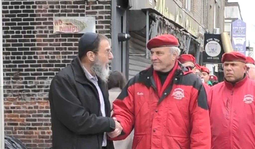 Curtis Sliwa, head of the Guardian Angels, a citizen safety group, on a newly reestablished patrol in the Jewish neighborhood of Crown Heights in Brooklyn, New York. Sliwa started the group in 1979 as a response to the then-rampant crime in the New York City subway. The group now has branches in over 130 cities and 13 countries worldwide. Older Jewish residents of the neighborhood, remember the Guardian Angels' presence during the 1991 Crown Heights riots, when the police largely let widespread violence against Jews go unanswered. (Photo: video screenshot)