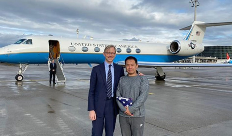 Xiyue Wang, the American jailed by Iran, with the State Dept.'s U.S. Special Representative for Iran Brian Hook (Photo: State Department)