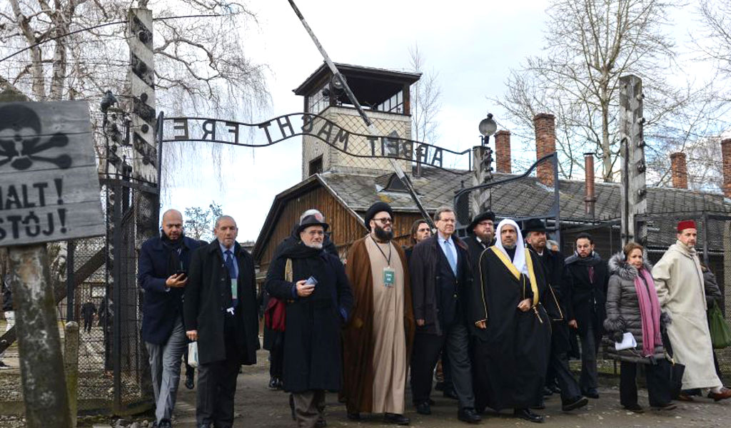 Dr Mohammad Abdulkarim Al-Issa (5th R), secretary general of the Muslim World League visits Auschwitz with American Jewish Committee (AJC) CEO David Harris (5th L) on January 23, 2020. The historic visit commemorated 75 years since the liberation of Auschwitz, the World War II death camp where the Nazis killed more than a million Jews. (Photo: BARTOSZ SIEDLIK/AFP via Getty Images)