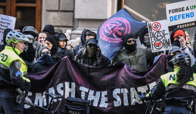 Antifa protesters in NYC holding a sign which reads, 'SMASH THE STATE' in a previous protest in NY. Bot Twitter accounts by 'Antifa' have been trying to stoke violence in the current upheaval (Photo: Stephanie Keith/Getty Images)