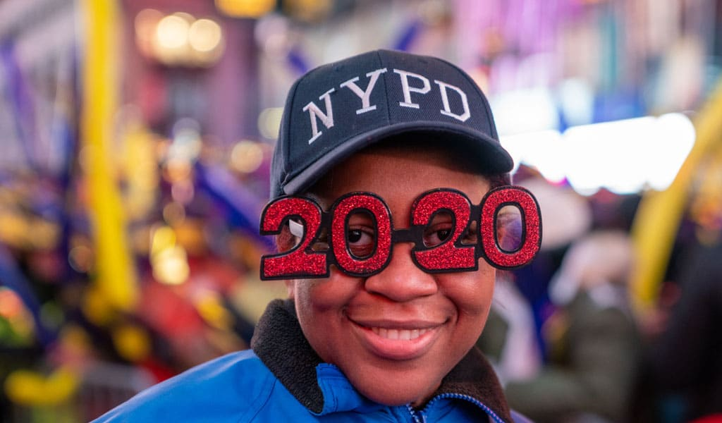 A police officer celebrates in Times Square during the New Year's Eve celebration on December 31, 2019 in New York City. (Photo: David Dee Delgado/Getty Images)