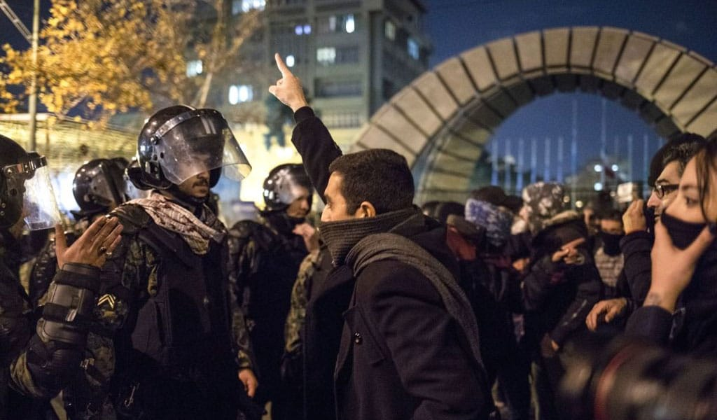 Iranian protester confronts a regime security officer. Why the Democrat silence on support for the anti-regime protesters? (Photo: AFP via Getty Images)