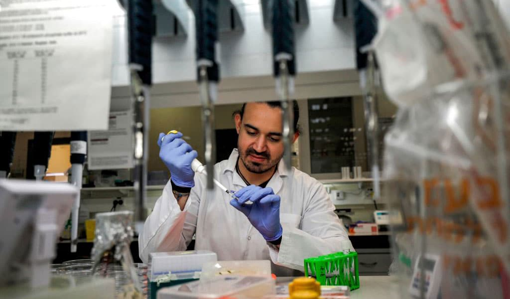 An Israeli scientist works at a laboratory at the MIGAL Research Institute in Kiryat Shmona in the upper Galilee in northern Israel on March 1, 2020 where efforts are underway to produce a vaccine against the COVID-19 coronavirus adapted from another for infectious bronchitis virus. (Photo: JALAA MAREY/AFP/ Getty Images)