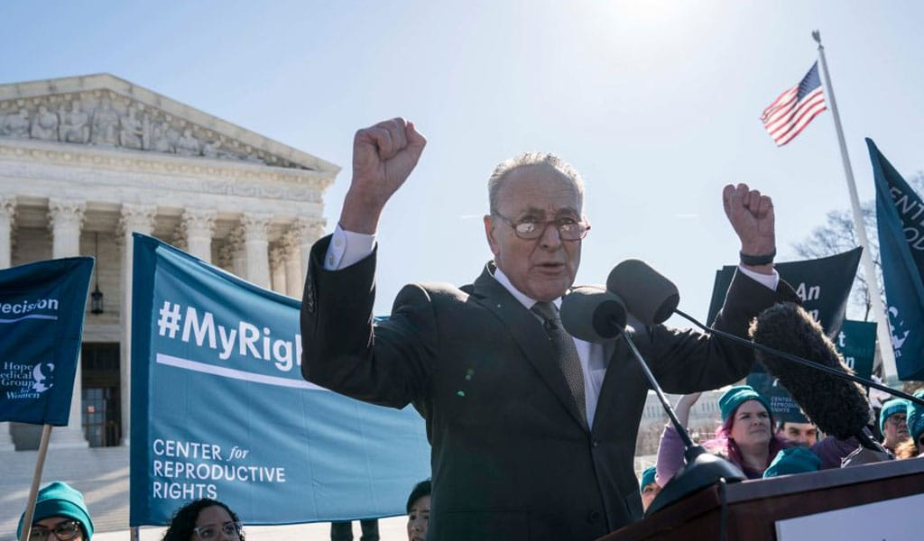 Senate Minority Leader Democrat Chuck Schumer threatens two conservative Supreme Court justices over an abortion case the court is hearing (Photo; Sarah Silbiger/Getty Images)