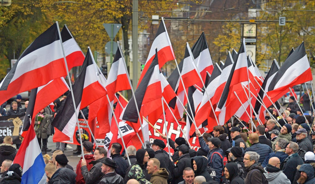 Neo-Nazis in Germany march in support of Holocuast denier Ursula Haverbeck, who is serving a two-year sentence for her outspoken denials regarding the Holocaust, which in Germany is a criminal offense. The march took place in 2019 on the anniversary of Kristallnacht, the 1938 Nazi-led pogrom against synagogues and Jewish-owned businesses across Germany. (Photo: Thomas F. Starke/Getty Images)