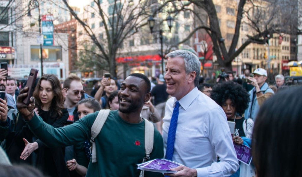 NYC Major Bill De Blasio distributes literature about coronavirus in Union Square on March 9, 2020. President Trump shut down travel from China on January 31, 2020 (Photo: Jeenah Moon/Getty Images)