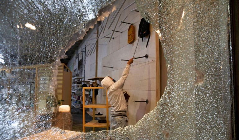 A looter in a Seattle Urban Outfitters store. Riots have erupted across America after the brutal murder of George Floyd by a police officer. (Photo: Karen Ducey/Getty Images)
