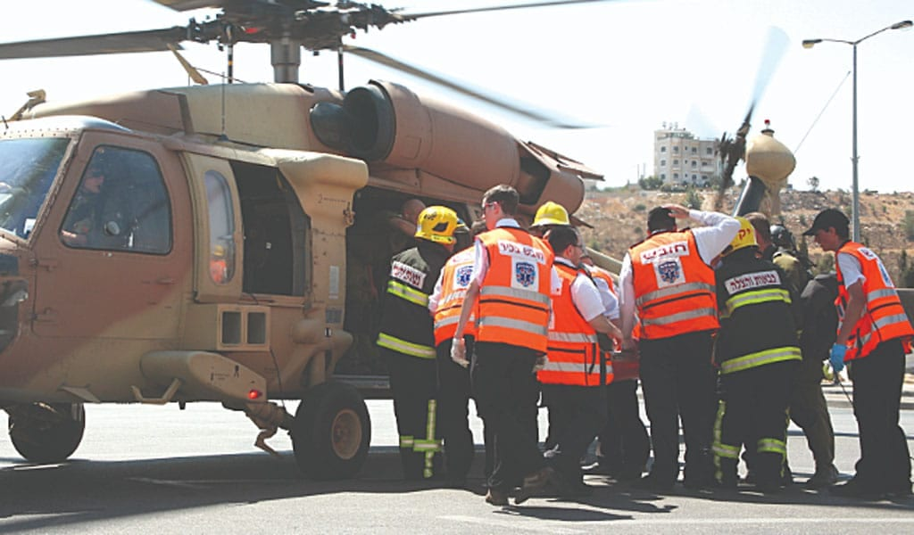 Israeli EMT's for the volunteer company United Hatzalah at a helicopter rescue (Photo: Wikimedia Commons)
