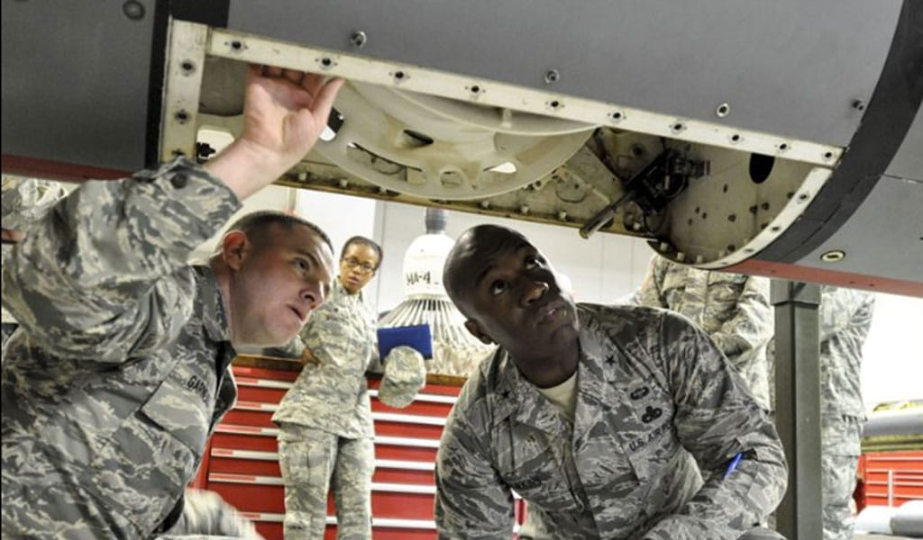 Master Sgt. Dustin Garneau shows Brig. Gen. Stacey Hawkins part of a KC-135 Stratotanker brought in for repair at Fairchild Air Force Base, Wash. (Illustrative photo: U.S. Air Force photo/Airman 1st Class Taylor Shelton)