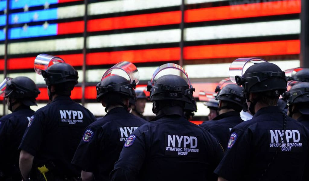 NYPD officers at protests in Times Square (Photo: TIMOTHY A. CLARY/AFP via Getty Images)