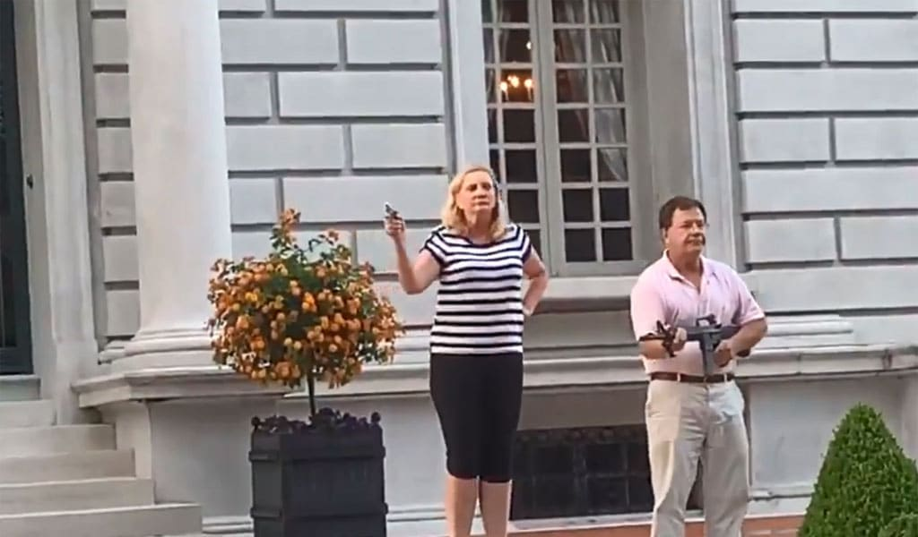 The McCloskey's, brandished guns at the protesters who they said had threatened their lives (Photo: Twitter)