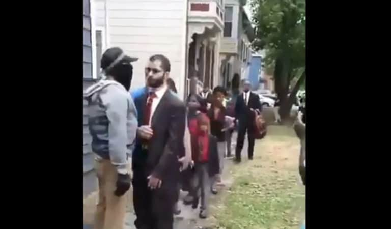 A BLM protester attempts to stop a line of worshipers from entering the Grace Baptist Church in Troy, NY (Photo: Twitter)