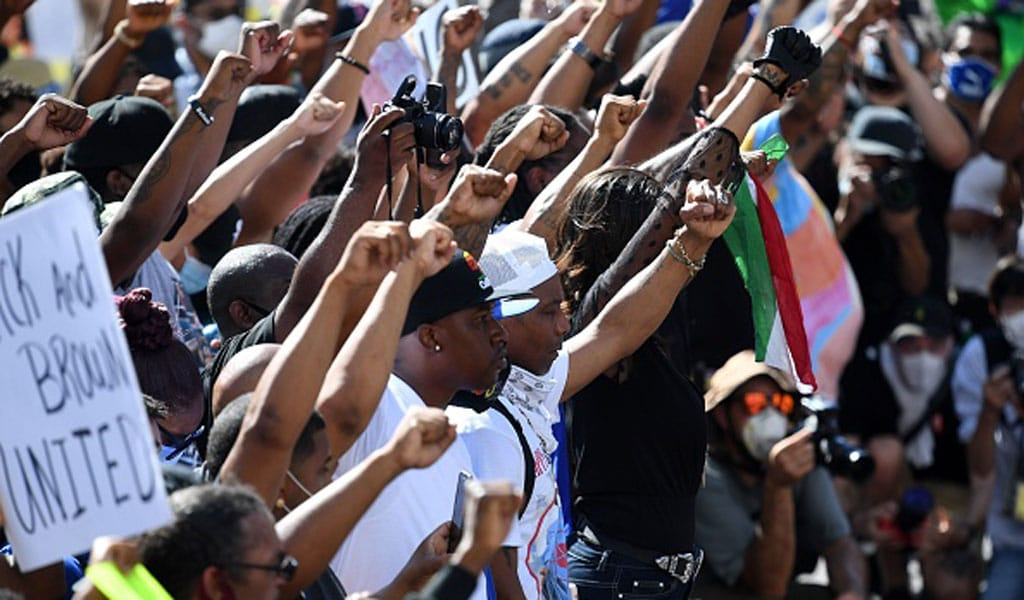 Protesters at the Los Angeles Unity March and Day of Action demanded justice for victims of police brutality on July 12, 2020 (Photo; ROBYN BECK/AFP via Getty Images)